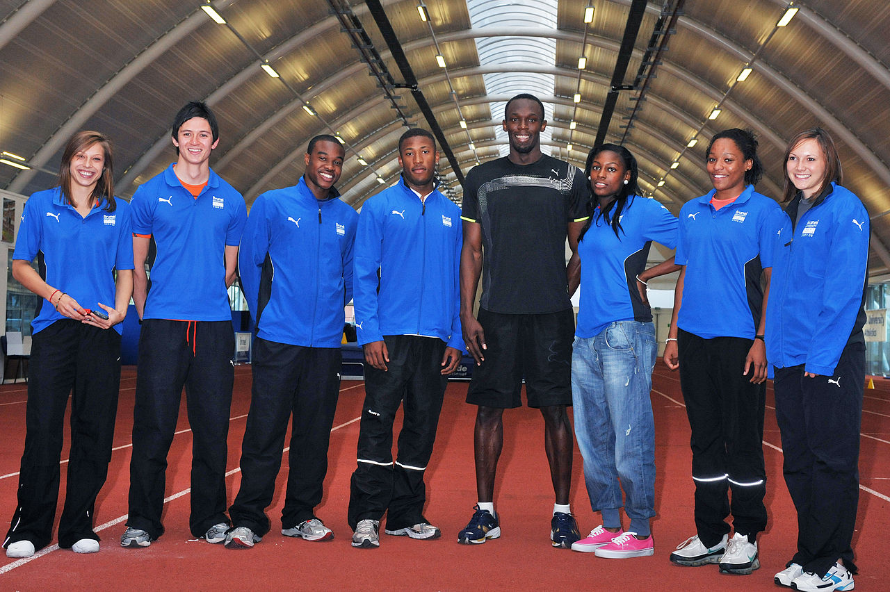Usain Bolt pictured with seven of Brunel's student athletes